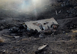 Remnants of a house engulfed in lava from Mt Etna