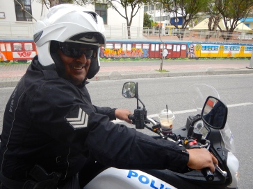 Checkout the coffee cup holder on the Police bike (looks like Geek behind the sunnies)