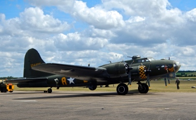 Boeing B17 being towed in to position before heading to the grass airfield for take off