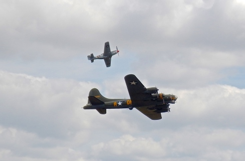 Mustang pulling away from the B17