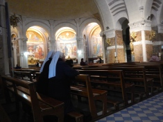 At prayer in Lourdes Basilica