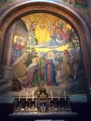 One of the many ceramic tiled images inside Lourdes Basilica