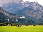 Neuschwanstein Castle dwarfed by the high mountains