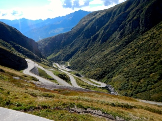 Looking down the many tyre wearing turns of Splugen Pass In Swiss Alps