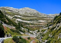 Heading up Furka Pass but the zig zagging road ahead climbs to Grimsel Pass