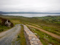 Small dirt switch back road in Donegal Ireland