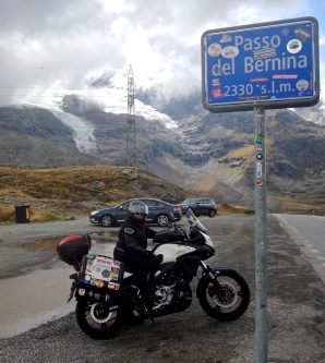 Riding roads in Italian Alps in amount glacial mountains