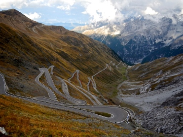 Italy's Stelvio Pass has over 40 hairpin turns on each side, that why bikers like it :-)