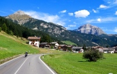 Italy's mountains and blue skies. = A great day for riding