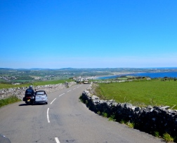 Isle of Man has plenty of great touring roads, just don't run into the Rock fences