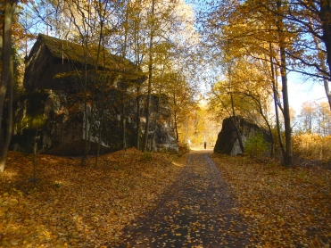 Road near Wolfs Lair in North Poland with remains of destroyed WW2 bunker