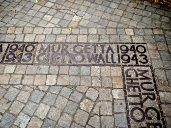 Markings on street of site of Ghetto wall