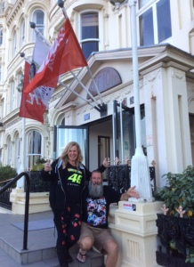 Jackie & Gary outside their hotel with the calling card stuck to the entry