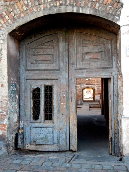 Some archways have lovely old wooden doors