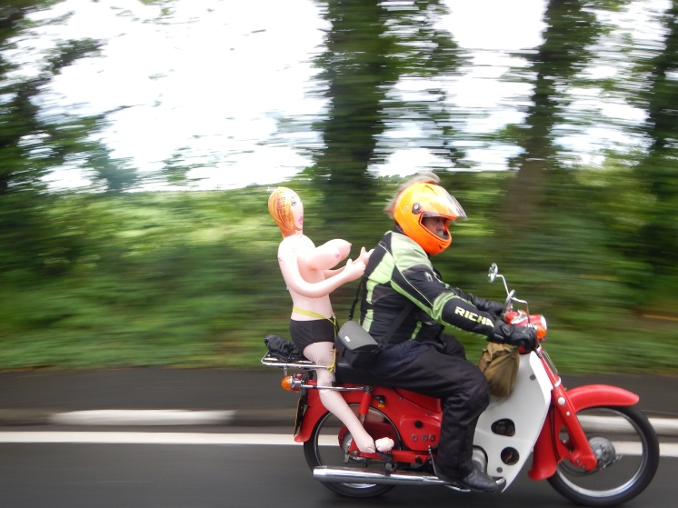 What a disgrace ! Not one piece of safety gear on his pillion passenger....