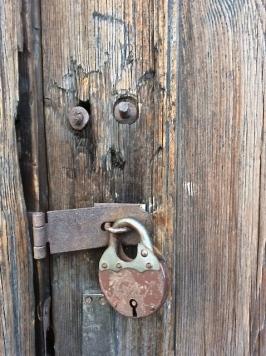 Old padlock .. old door