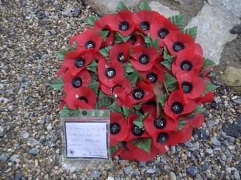 A red poppy wreath left by the Children from St Catherine's school, Bramley UK
