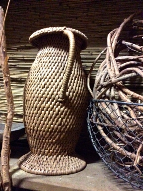 This jug made of the roots on the right will hold water. It is 100 years old