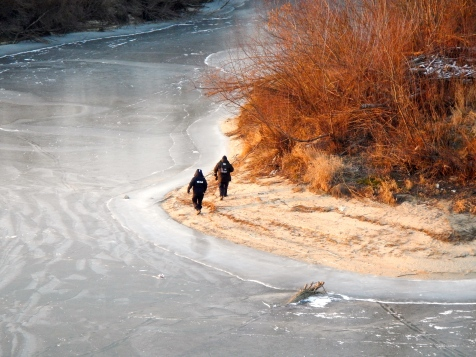 Police looking for kids walking over the iced up Vistula river - love the colour contrast