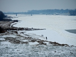 The Vistula river all iced up and the beach covered with snow