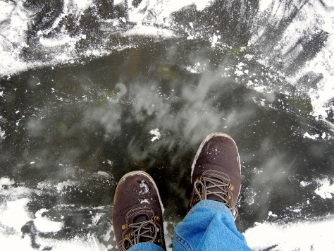 A surreal feeling to be standing on this ice and watching the fast water flowing beneath