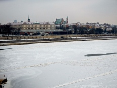 The Vistula river is all ice and snow as it looks to the Old Town