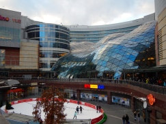 Modern shopping centre with ice rink in foreground