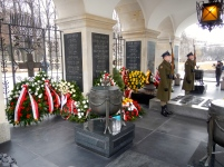 Tomb of the Unknown Soldier in Piłsudski Square - see the green and gold Aussie flowers from Australia behind the guards