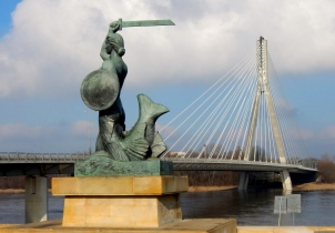 Statue of Warsaw's mermaid down on the banks of the Vistula river