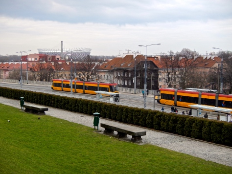 Trams in Warsaw colours of red and yellow OR.... yellow and red - viewed from the Royal castle gardens