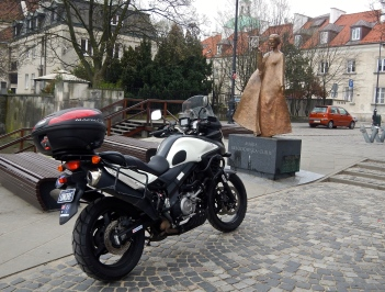 Vstrom looking towards Madame Curie statue - a famous daughter of Poland