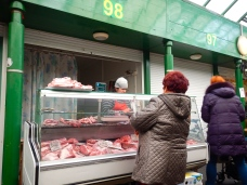 One of many meat stalls at Hala Mirovska market