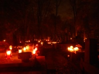 Warsaw cemetery by night on All Saint's Day with a beautiful red hue