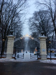 Łazienki park entrance with some christmas lights still shining