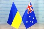 Ukraine and Australian flags. The Ukraine flag - the blue is for the sky, mountains and streams and the yellow is for the wheat