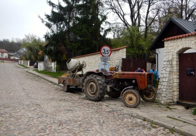 Bumpy old cobblestone road and tractor