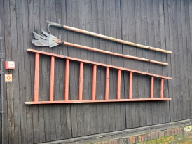 Tools on the outside wall of each hut