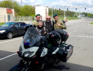 Border Guards from the Ukraine Military - happy to have a pic with two Oldies! Usually we can not take pictures at the border, but these young guys were very taken by the bike, our stickers and our travels... And our ages! They say their parents never would never adventure like us.. Bless..