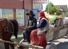 Gypsies on their way into the village by horse and cart