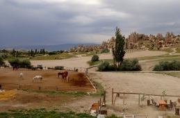 Seeing the Cappadocia area by horseback is very popular. The grey sky is a lovely contrast of colour