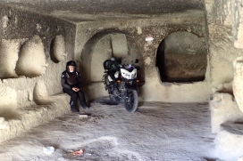 One of the many caves carved in the rock in Rose Valley near Goreme. You can see the black on the walls from the fires. And NO.... we did not leave the KooWeeRup sticker there! Putting the bike in there gives a idea of how bigg it is. Incredible to think we sat where people lived in the 11th century