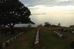 Beach Cemetery on the north coast as the sun sets over a very calm sea