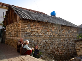 Ladies catching the afternoon sun in the village Lin in Albania
