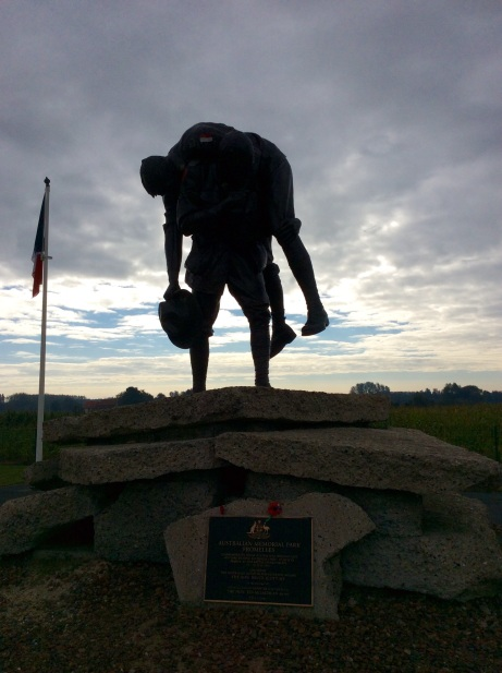 Australian statue 'Cobbers' in France, makes a sombre silhouette in the evening sky