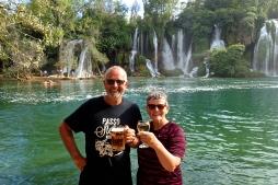 Bosnia - water falls near Medugoje - enjoying a cool drink after a swim