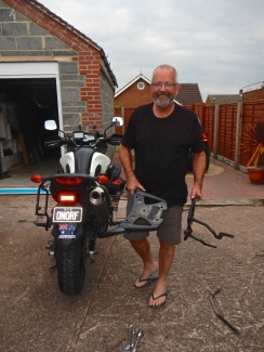 Good to have friends with tools !! Replacing damaged pannier rack at Julie and Barry's home in the Midlands England
