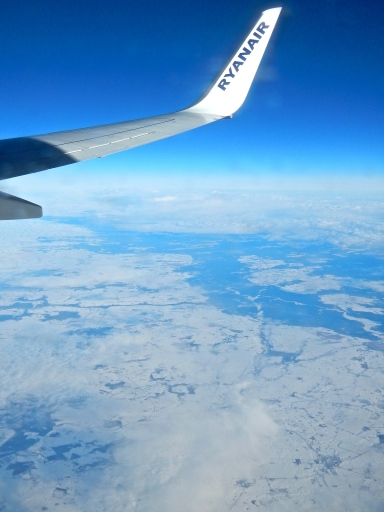 On our way to Brussels on low cost airline Ryan Air - Flying over snow covered Poland