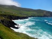 Green farmland runs down to Irelands western coastline