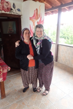 TWINS - We always try to learn local language for Hello, Goodbye and Thank you.. Jo took it one step further and dressed like the locals !!